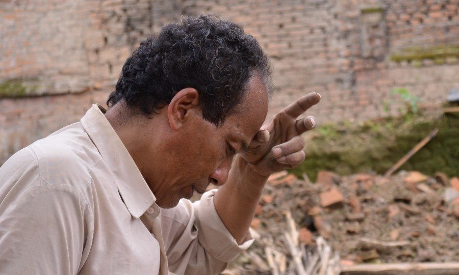 Lakshman Shrestha clears the rubble of his house following the Nepal earthquake.
