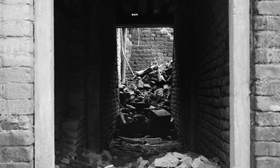 The sun shines into a tunnel of debri in Sakhu, Nepal, after the earthquake.