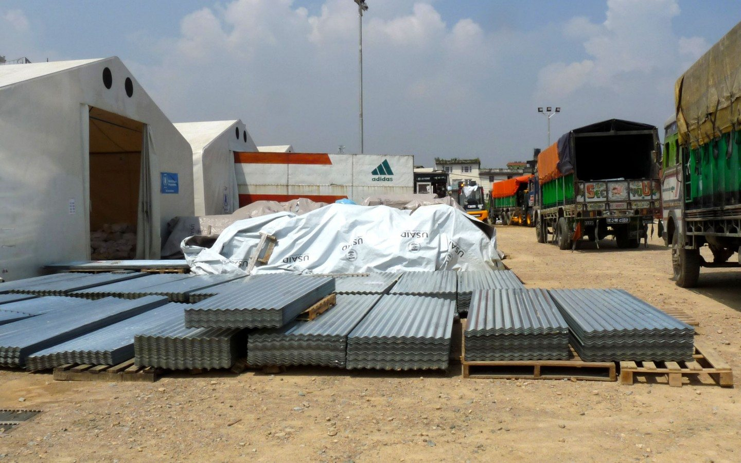 Zinc roofing materials for homes and shelters awaits distribution at the WFP base in Kathmandu.