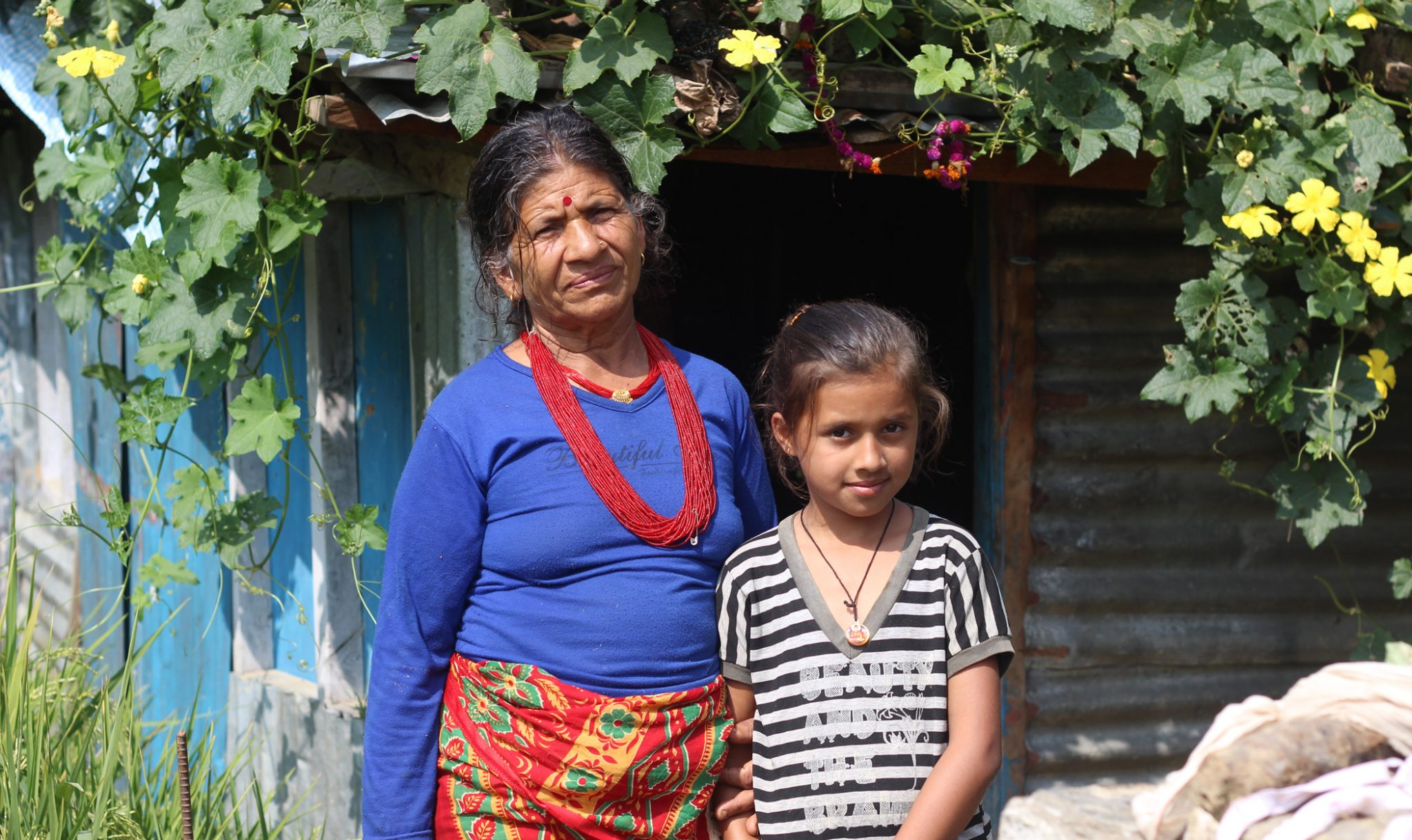 Bal Kumari Parajuli and her granddaughter, Dikshika, who now lives in Kathmandu with her parents