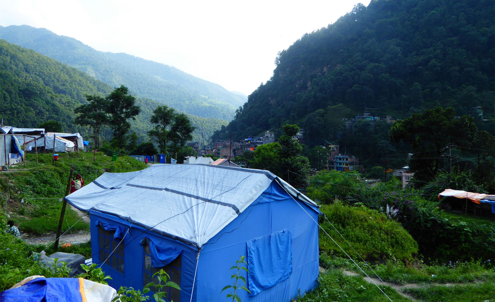 In Sindhupalchok, the district worst affected by the earthquake, thousands still live in temporary shelters. This is one such camp in Bahrabise, close to the Chinese border. Photo: Patrick Ward
