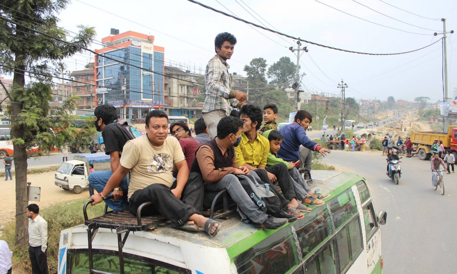 Commuters sit on the roof of a bus in Kathmandu during during the fuel crisis.