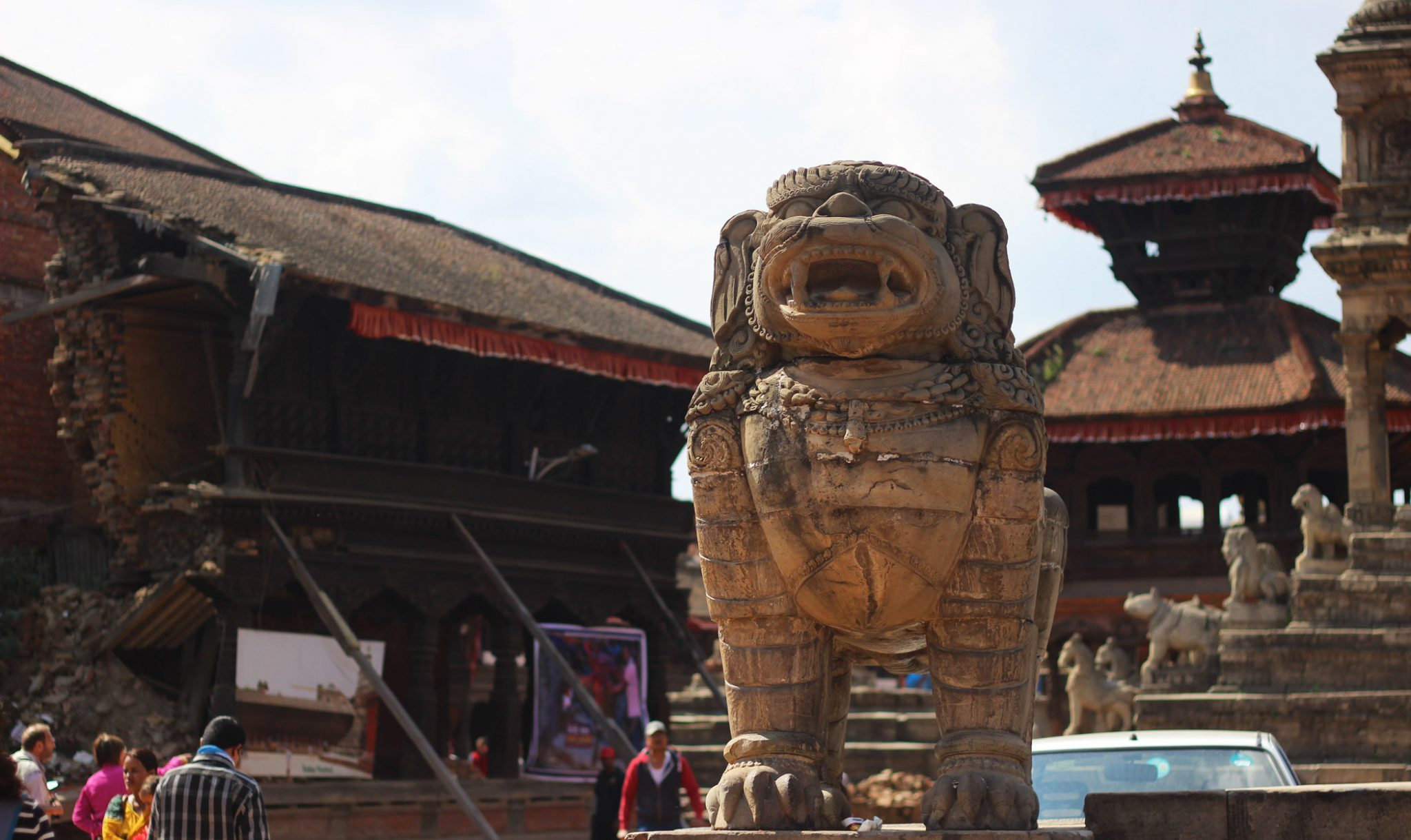 A set of two stone lions stand on their own in Bhaktapur's Durbar Square. It is thought that the temple they used to guard was destroyed by the 1934 earthquake, the worst in Nepal's history. Nearly a third of the city's temples and buildings were destroyed in that earthquake, which measured 8.0 in magnitude.