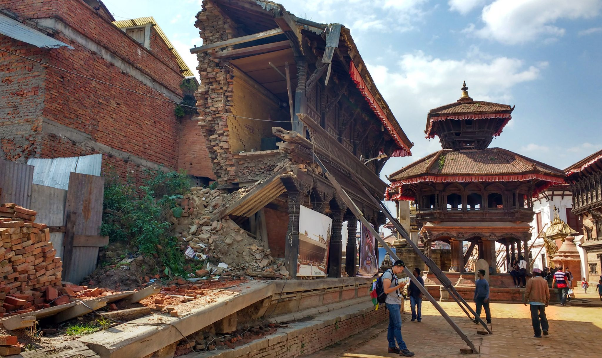 Right at the centre of Bhaktapur Durbar square lies a 15th-century palace, sections of which collapsed in the recent quake. The interior has remained closed since the 1934 earthquake. The courtyard surrounding it still lies in ruins and the uncleared debris from the broken down buildings have now become a part of the temple complex.