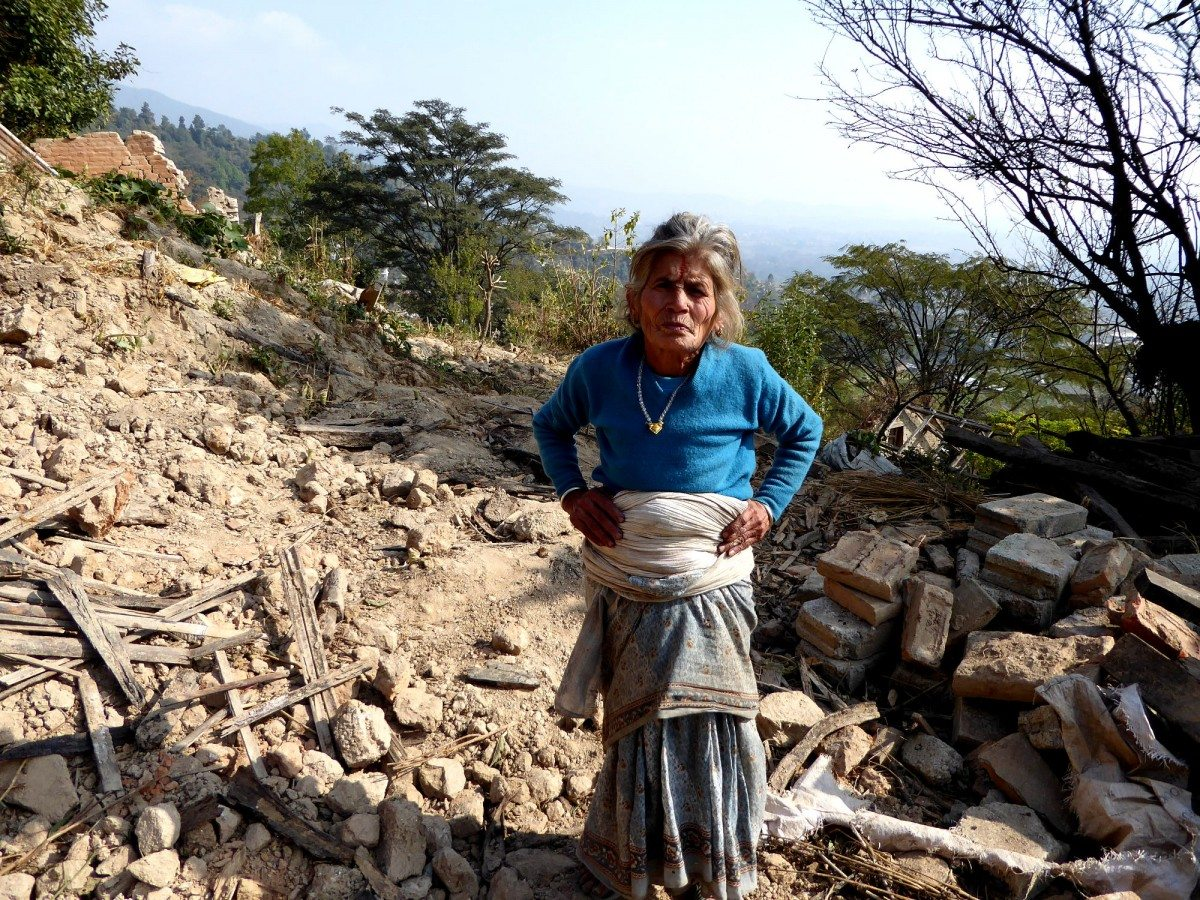 Seti Lamichhane stands in the ruins of her house in Kahvresthali